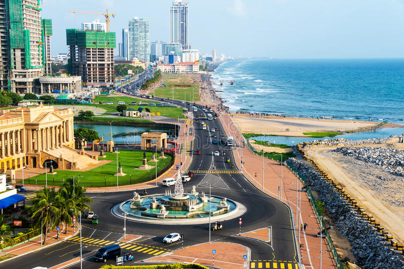 Aerial view of Colombo, Sri Lanka modern buildings. With coastal promenade area. Car traffic during the day. Ocean waves stock images