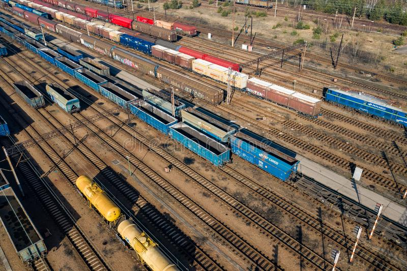 Aerial view of colorful freight trains on the railway station. Wagons with goods on railroad. Heavy industry. Industrial royalty free stock photos