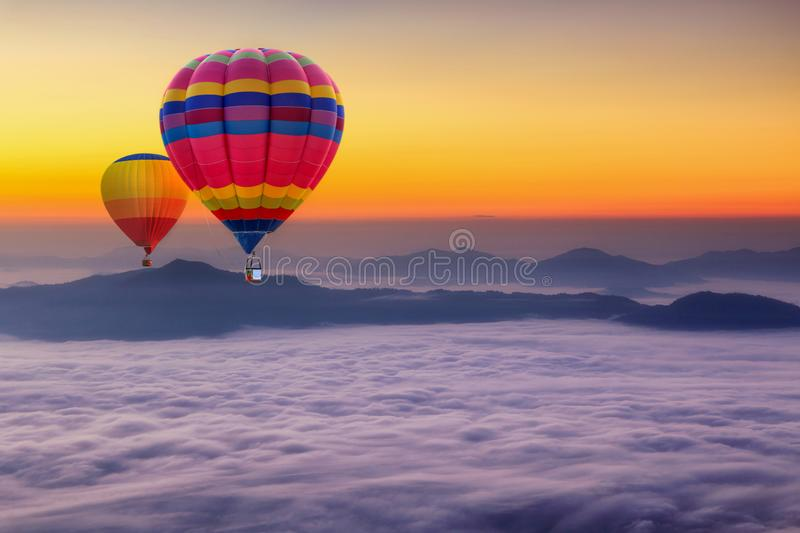 Aerial view from colorful hot air balloons flying over with the mist at Pha Tung mountain in sunrise time stock photography
