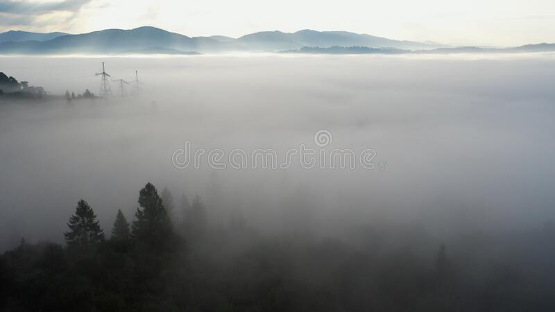 Aerial view of colorful mixed forest shrouded in morning fog on a beautiful autumn day royalty free stock photos