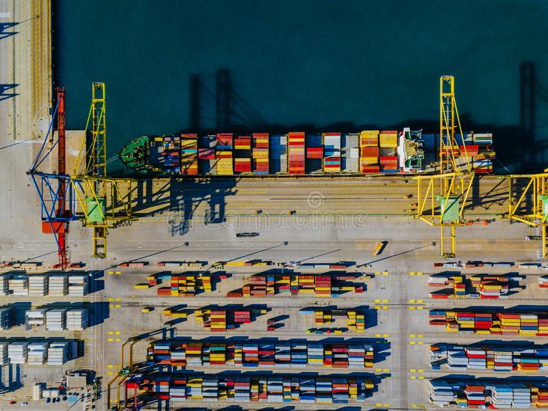 Aerial view of the commercial port of Valencia. Container terminal and ship during loading. royalty free stock photo