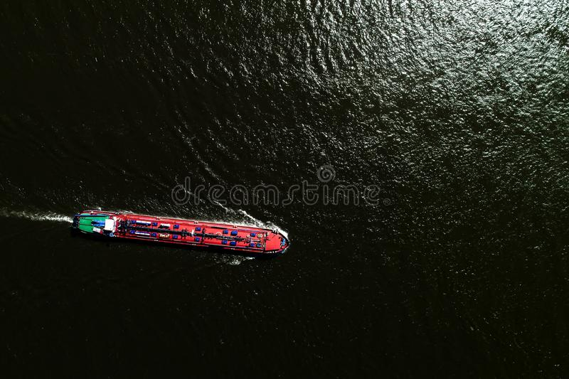 Aerial view commercial ship crossing the River Rhine in an area. Of the Netherlands royalty free stock photos