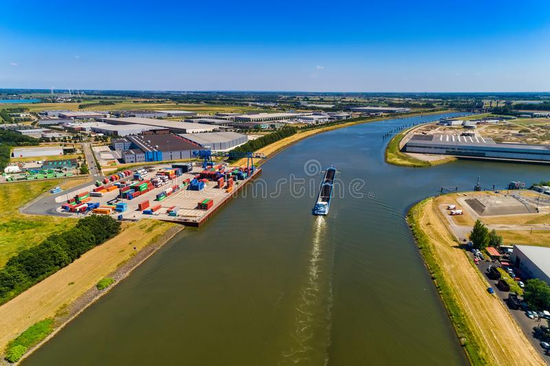 aerial view commercial ship crossing the River Rhine in an area royalty free stock image