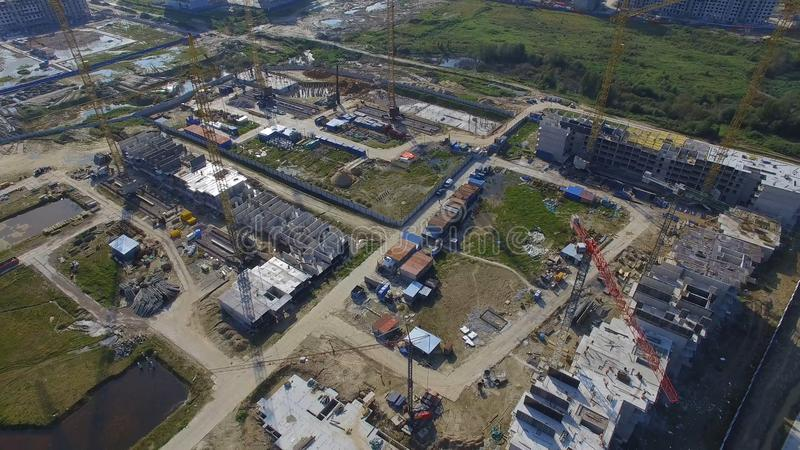 Aerial view on construction building. Construction site workers, aerial, Top View. Overhead view of construction site stock photos