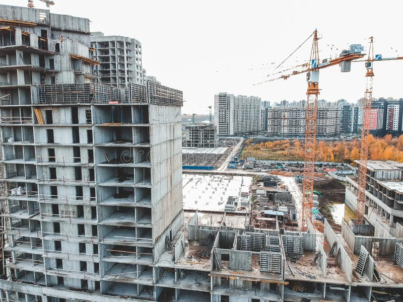 Aerial view for the construction of a residential building, tower crane. Autumn, St. Petersburg, Russia. Aerial view for the construction of a residential royalty free stock photography