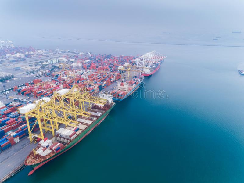 Aerial view container ship loading container from sea port warehouse for delivery containers shipment. Suitable use for transport. Or import export to global royalty free stock image