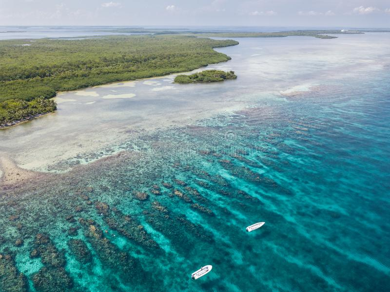 Aerial View of Coral Reef and Small Boats in Belize royalty free stock photography