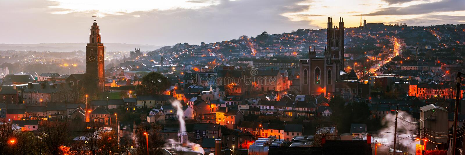 Aerial view of Cork, Ireland at sunset. Aerial view of St. Anne`s Church and Cathedral in Shandon, Cork, Ireland. Mountains and sunset cloudy sky royalty free stock photos