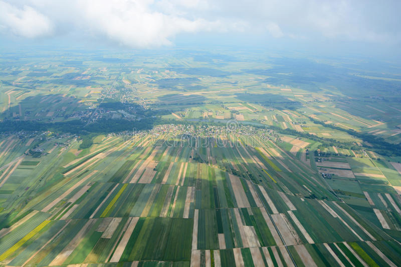 Aerial view of the countryside with village and fields of crops royalty free stock images