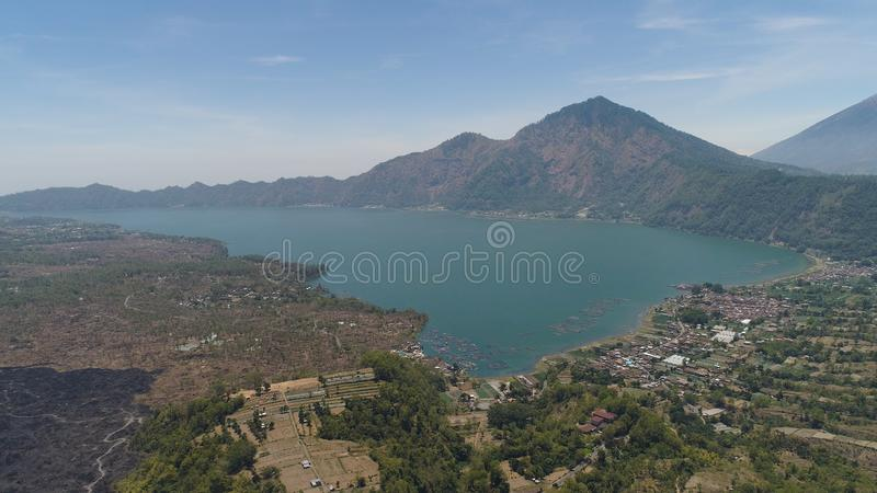 Mountain landscape lake and volcano Batur. Aerial view crater lake and volcano Batur mountain landscape with volcanoes, lake with sky and clouds Bali, Indonesia royalty free stock photography
