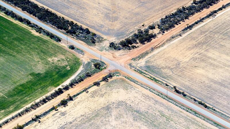 Aerial view of a crossroads in rural Western Australia. Aerial view of a crossroads in Merredin, Western Australia. Concept of choice, crossroads in life, which stock photos