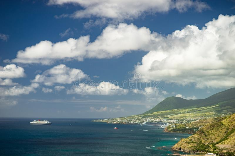 Aerial view of cruise ship near Caribbean island with green mountains stock images