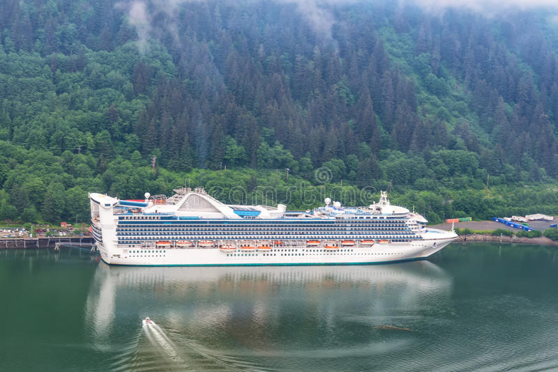 Aerial view of cruise ship at port in Juneau, Alaska. Aerial view of cruise ships at port in Juneau, Alaska with low lying fog and clouds shrouding mountains royalty free stock photography