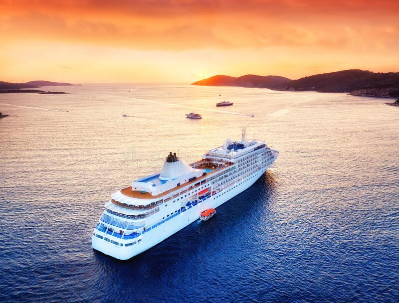Aerial view at the cruise ship during sunset. Adventure and travel. Landscape with cruise liner on Adriatic sea. Luxury cruise. Aerial view at the cruise ship royalty free stock image