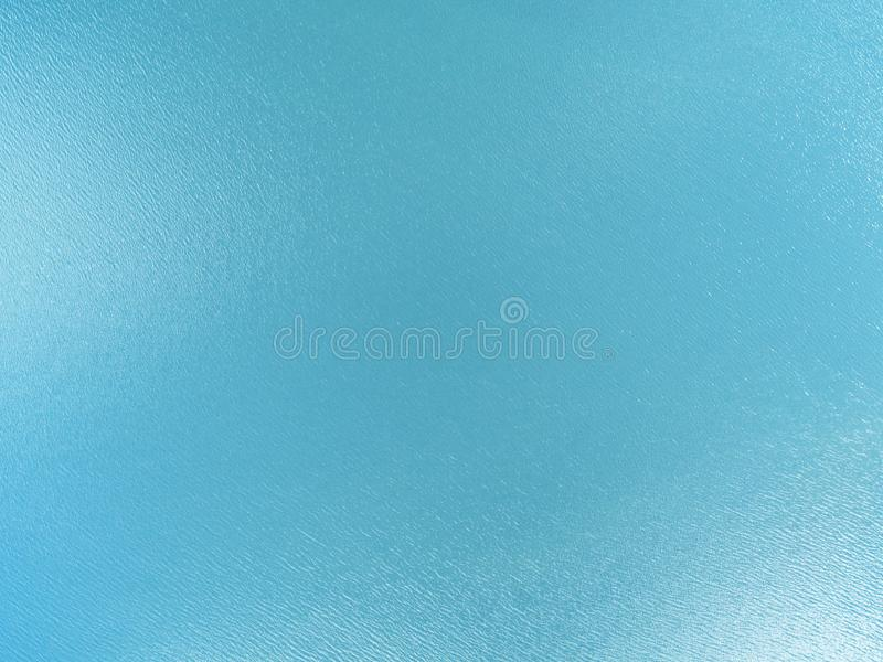 Aerial view of a Crystal clear sea water texture. View from above Natural blue background. Turquoise ripple water reflection in tr. Opical beach. Blue ocean wave royalty free stock images