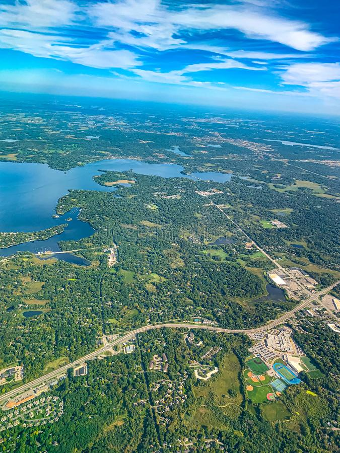 Aerial view of a densely forested urban development. Aerial view of a densely forested planned urban development in a major US city. There is a lake to the left stock photography