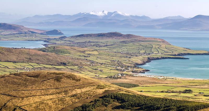 Aerial view of Dingle bay. Co Kerry, Ireland, with snowy Carrauntoohill mountains in the background royalty free stock image