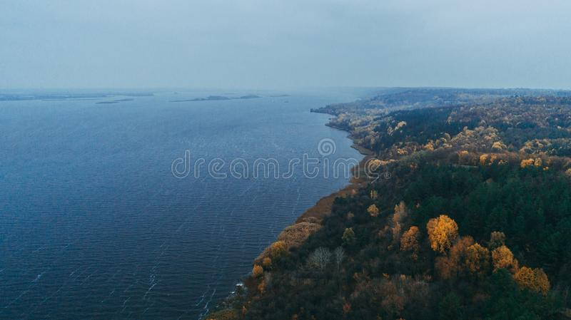 Aerial view of the Dnieper River. Yellow trees. Autumn. Aerial view of the Dnieper River, Yellow trees. Waves. Autumn stock image