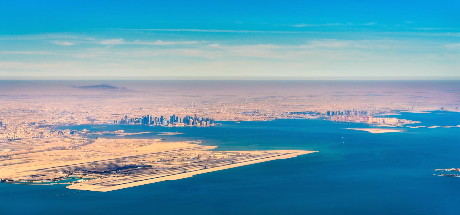 Aerial view of Doha and Hamad International Airport. Qatar, the Middle East royalty free stock photo