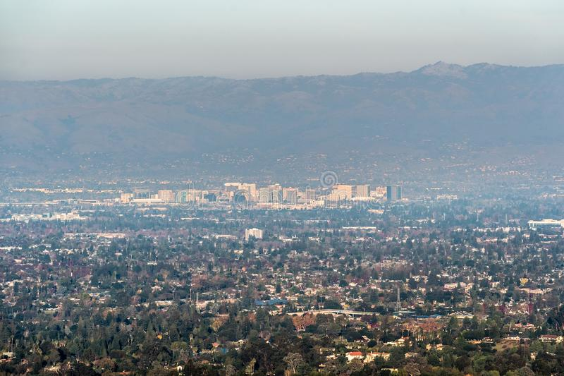 Aerial view of downtown San Jose on a sunny afternoon; Silicon Valley, south San Francisco bay area, California; pollution and. Smog visible in the air stock photo