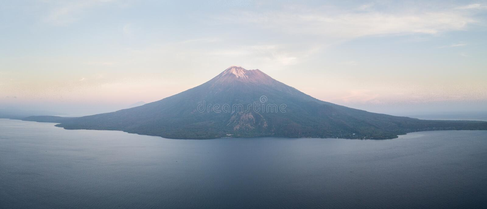 Aerial View of Dramatic Volcano in the Ring of Fire. The dramatic volcano of Ile Ape rises on the island of Lembata in Indonesia. This remote, tropical region royalty free stock photography