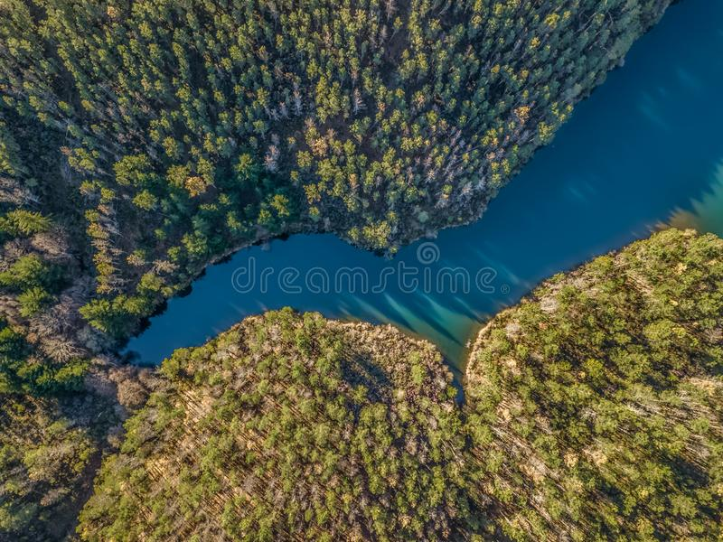 Aerial view of drone, artificial lake and dense forest on the banks stock photography
