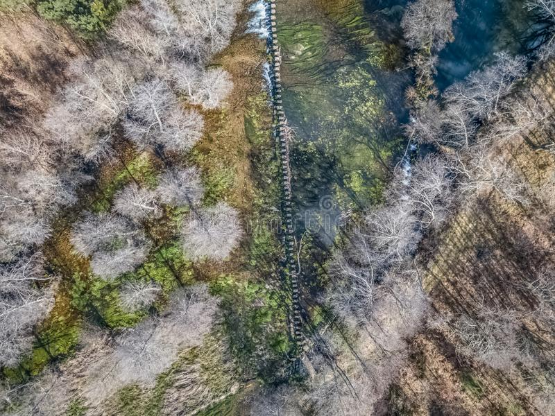 Aerial view of drone, artificial lake and dense forest on the banks stock photos