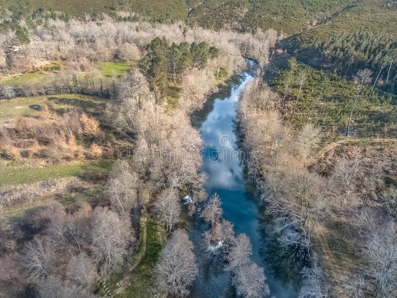 Aerial view of drone, artificial lake and dense forest on the banks royalty free stock photos