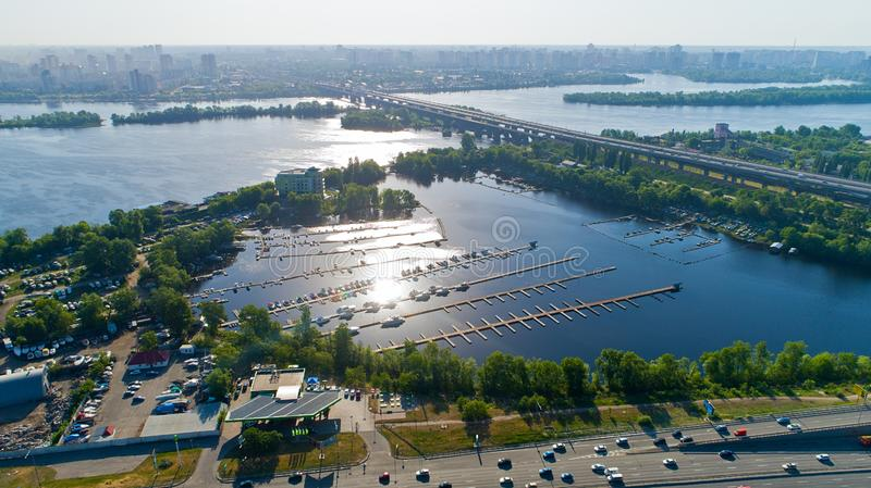 Aerial View Drone cityscape. Bridge over river and pier for boats royalty free stock images