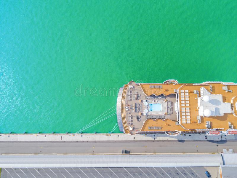 Aerial View by Drone of Cruise ship at harbour. Top view of beautiful large white liner in yacht club. Luxury cruise in sea water. Marina dock. Ship is moored royalty free stock photography