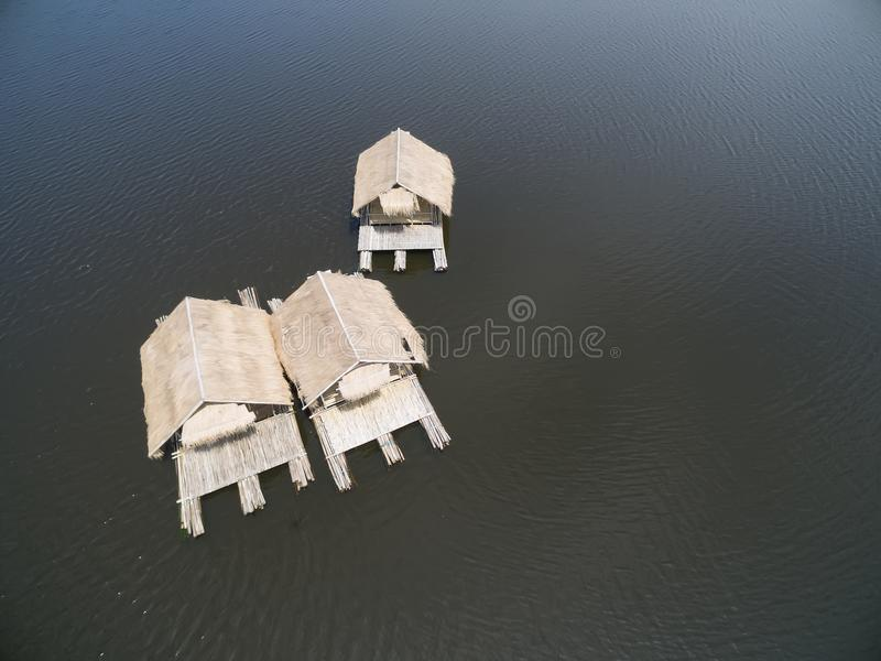 House raft floating in the lake. Aerial view from drone. group resort house raft floating in the lake for relax time royalty free stock images
