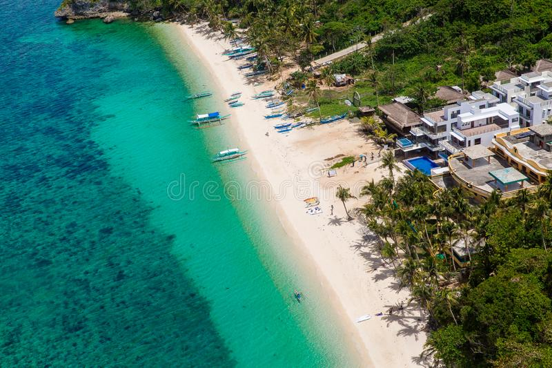 Aerial view from the drone on the landscape tropical island with  turquoise sea with boats, palm trees and hotels. Summer vacation. Concept stock images