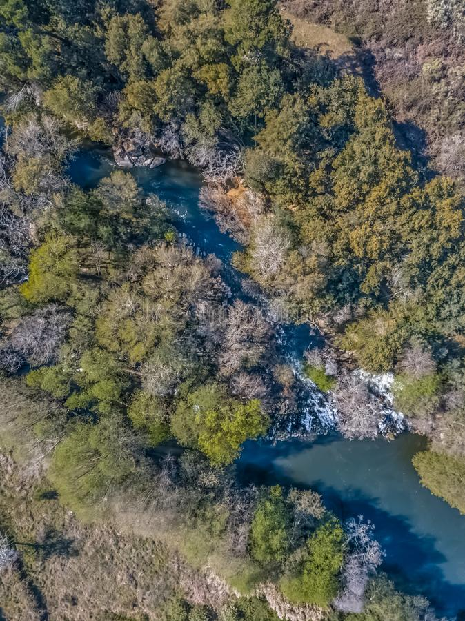 Aerial view of drone, natural landscape river with and colored trees on the banks stock photo