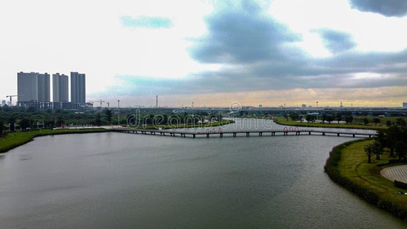 Aerial View or Drone Shot. Beautiful Green Lake - Indonesia, garden view and apartment buildings at Bekasi royalty free stock image