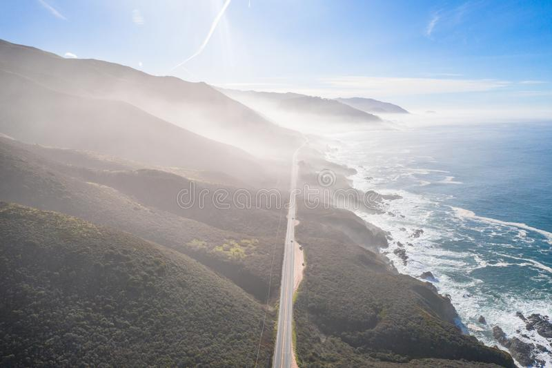 Aerial View Drone Shot of Highway Pacific Coast Highway California USA Big Sur Mountains Ocean Fog Sun royalty free stock image