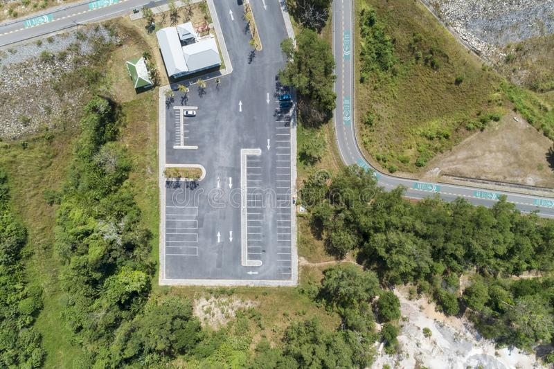 Aerial view drone shot of parking lot outdoors vehicles in the park stock photos