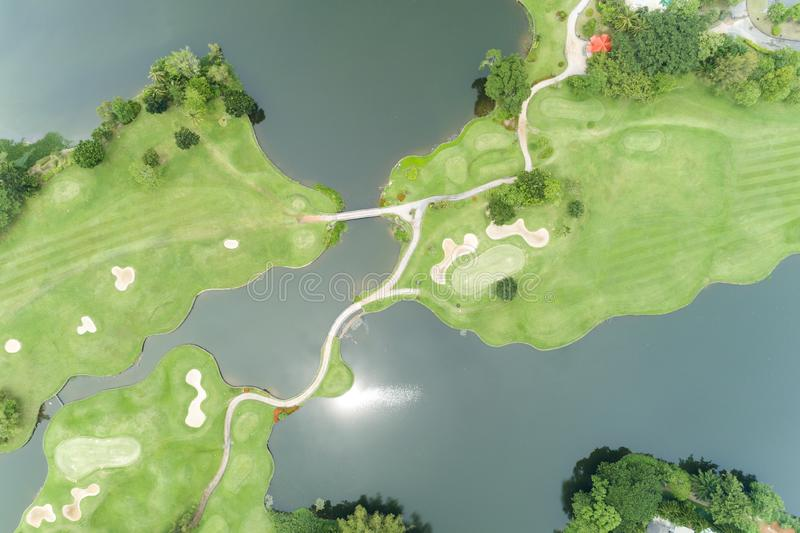 Aerial view drone Top down shot of beautiful green golf field High angle view in summer time royalty free stock photos