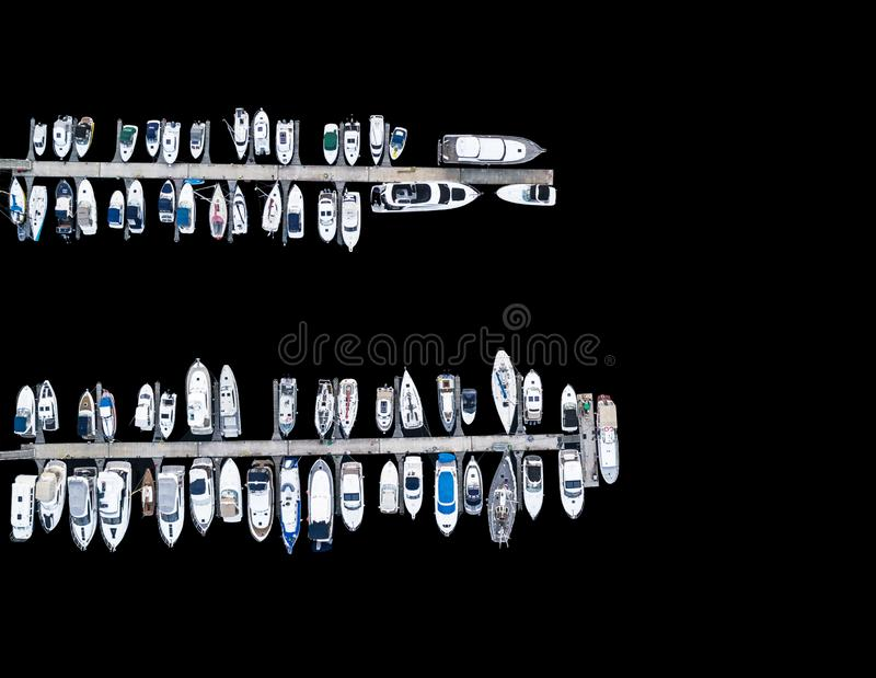 Aerial View by Drone of Yacht Club and Marina. Top view of yacht club. White boats in sea water. Marina dock yachts and small moto. R boats. Yacht and sailboat stock photography