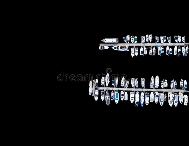 Aerial View by Drone of Yacht Club and Marina. Top view of yacht club. White boats in sea water. Marina dock yachts and small moto. R boats. Yacht and sailboat royalty free stock photo