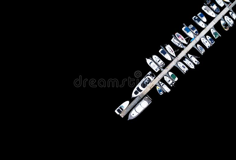 Aerial View by Drone of Yacht Club and Marina. Top view of yacht club. White boats in sea water. Marina dock yachts and small moto. R boats. Yacht and sailboat stock images