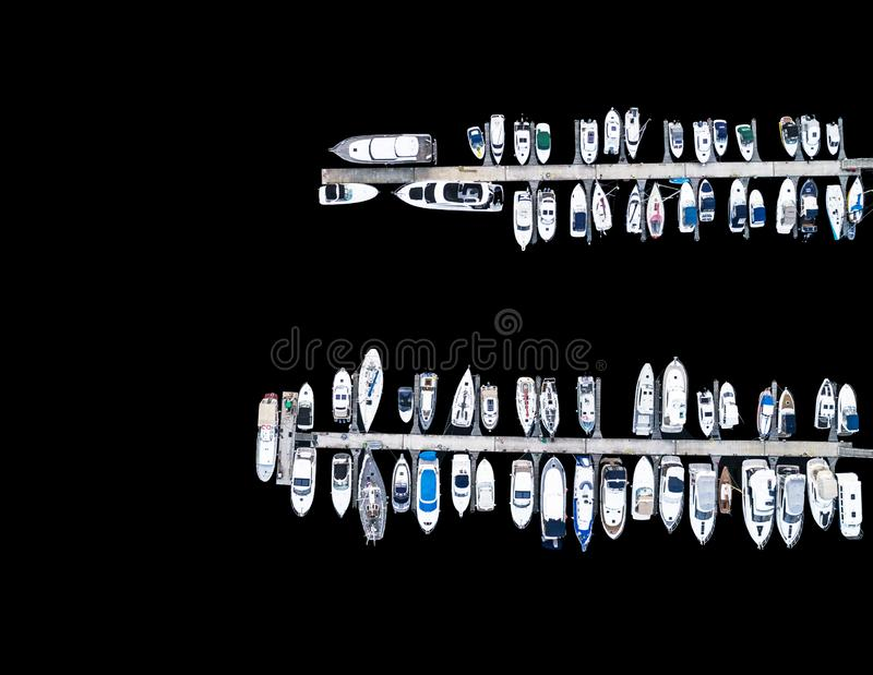 Aerial View by Drone of Yacht Club and Marina. Top view of yacht club. White boats in sea water. Marina dock yachts and small moto. R boats. Yacht and sailboat stock image
