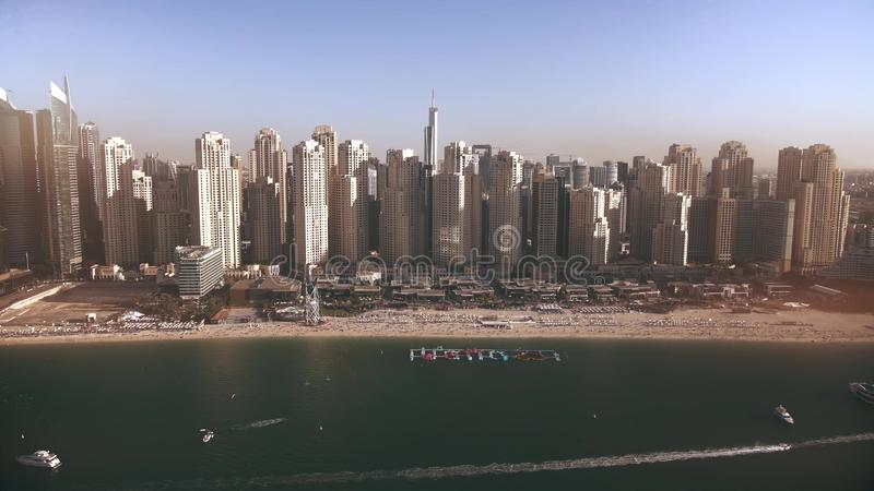 Aerial view of Dubai Marina skyscrapers and the beach as seen from sea, UAE stock image