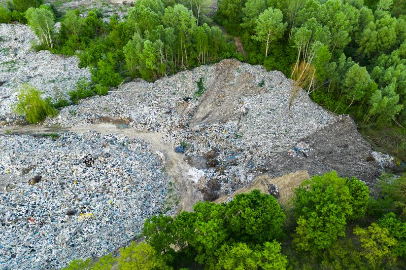 Aerial view of dump in forest. Pollution concept, top view. Aerial top view large garbage pile, Garbage pile in trash dump or landfill, Waste from household in royalty free stock photos