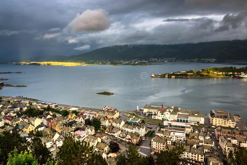 Aerial View of Eastern Alesund and The Fjord with Dramatic Sky after A Rain. Image of Alesund after the rain with little sunshine in Summer taken from Mount stock photos