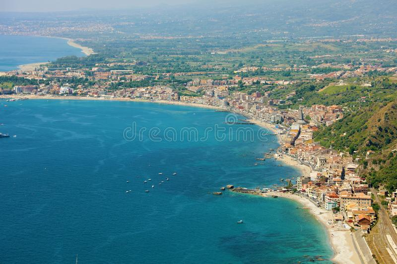 Aerial view of Eastern Sicily coast with blue sea. Beautiful Italy coastline royalty free stock images