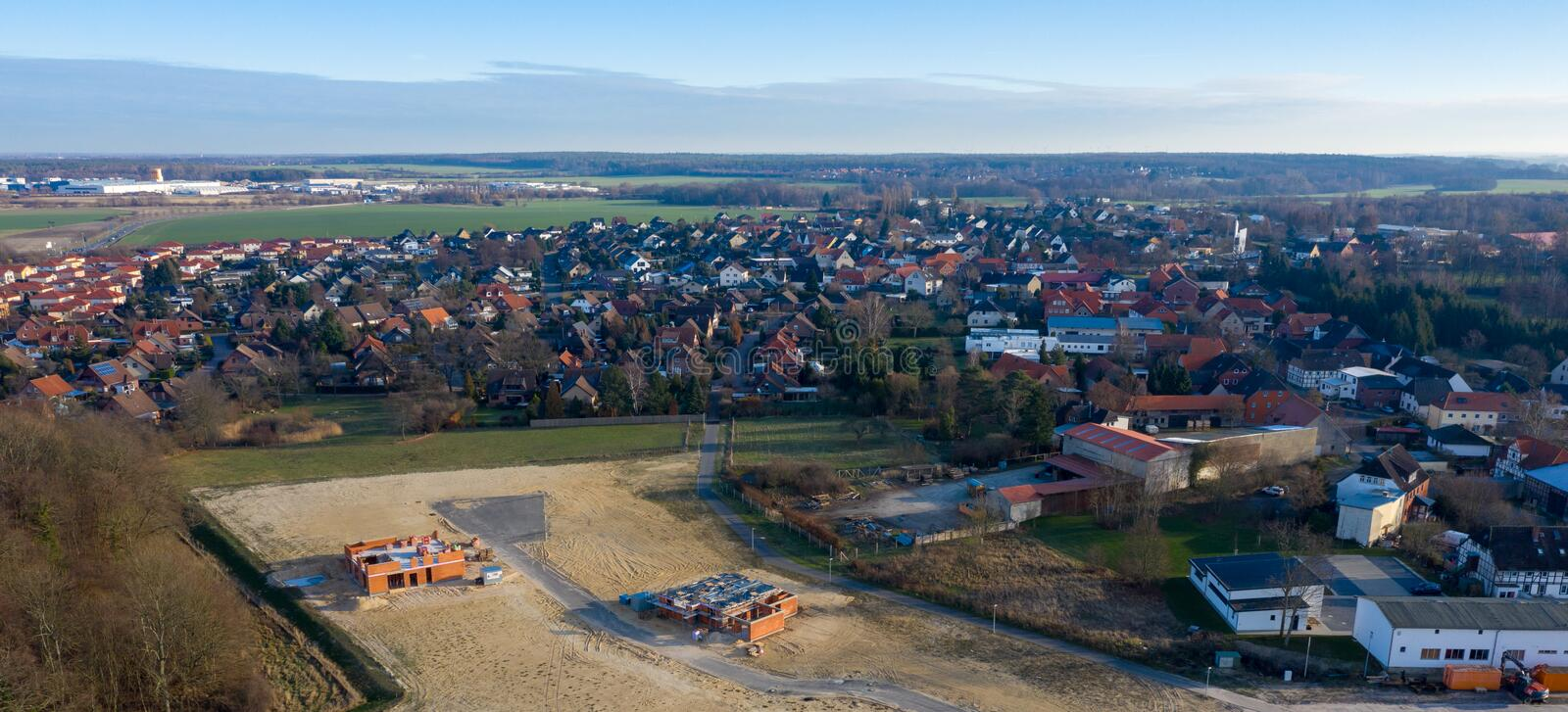 Aerial view of the edge of a growing village, followed by a new development area under construction. Aerial view of the edge of a growing village, followed by a royalty free stock photo