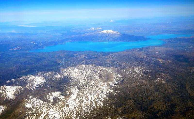 Aerial view of Egirdir lake and snow covered mountains stock images