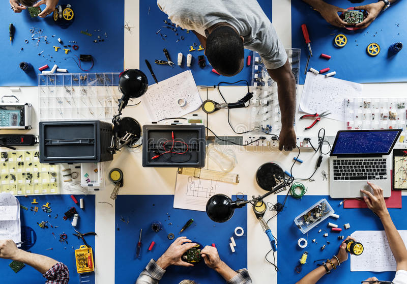 Aerial view of electronics technicians team working stock images