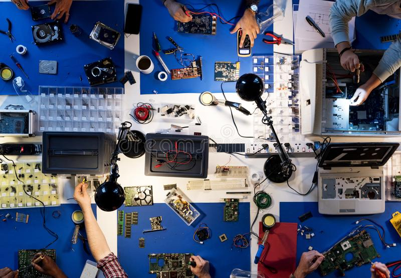 Aerial view of electronics technicians team working on computer. Parts royalty free stock image