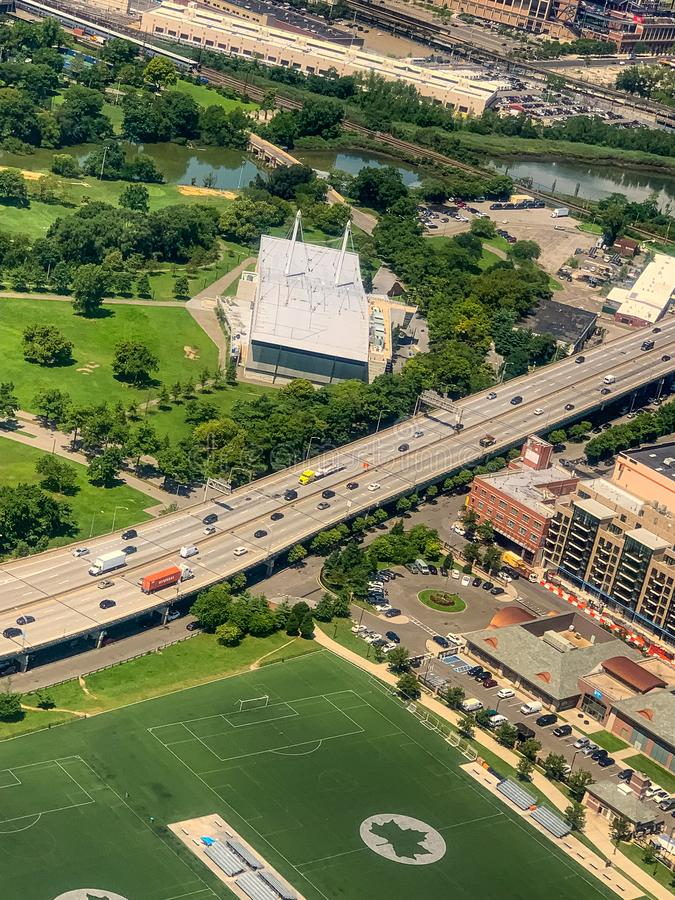 Aerial view of elevated roadway with surrounding community. New York US . Sports center in the foreground with a river and bridges in the distance stock photo